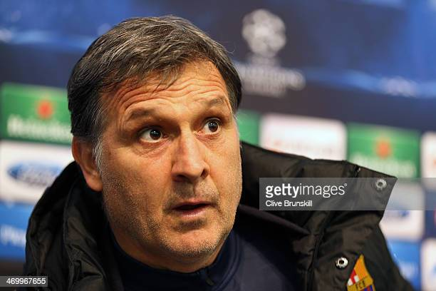 Barcelona manager Gerardo Martino arrives at a press conference prior to a training session ahead of their UEFA Champions League Round of 16 match...