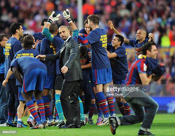 Barcelona manager Josep Guardiola celebrates with his team after they beat Real Valladolid 40 to clinch La Liga title after their match at Camp Nou...