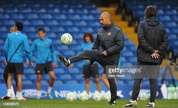Barcelona manager Pep Guardiola shows off his footballing skills during a training session ahead of their UEFA Champions League semifinal first leg...