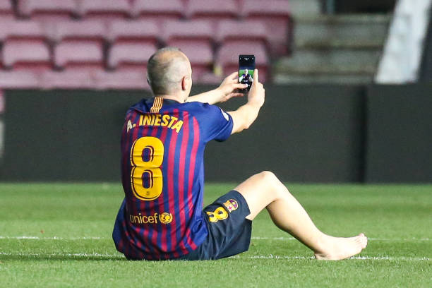 FC Barcelona midfielder Andres Iniesta alone in the grass of Camp Nou says goodbye to the stadium after playing his last game with FC Barcelona after...