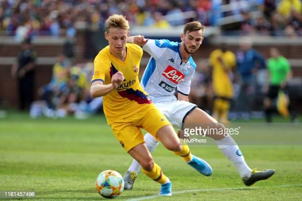 Barcelona midfielder Frenkie de Jong battles for the ball with Napoli midfielder Fabián Ruiz during the first half of the International Champions Cup...