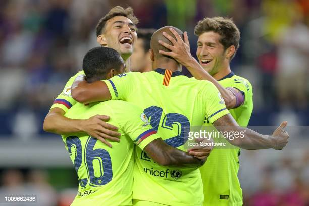 Barcelona midfielder Rafael Alcantara 'Rafinha' celebrates his goal with teammates during the first half of the International Champions Cup between...