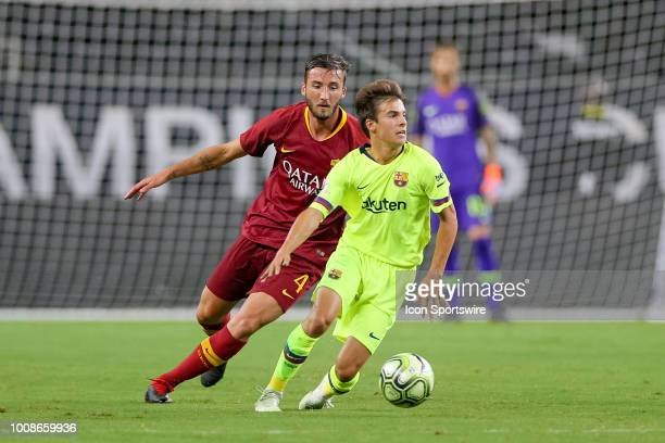 Barcelona midfielder Ricky Puig is tripped from behind by AS Roma midfielder Lorenzo Pellegrini during the International Champions Cup between FC...