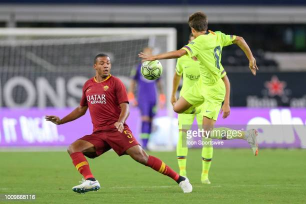 Barcelona midfielder Ricky Puig leaps to kick a ball over AS Roma defender Juan Guilherme Nunes Jesus during the International Champions Cup between...