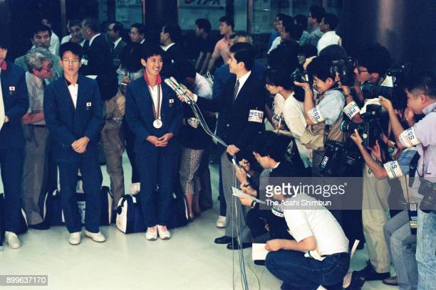 Barcelona Olympic Women's Marathon silver medalist Yuko Arimori and Men's Marathon silver medalist Koichi Morishita are interviewed on arrival at...