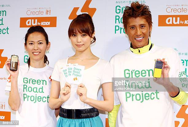 Barcelona Olympic women's marathon silver medalist Yuko Arimori model Yuri Ebihara and ex professional baseball player Tsuyoshi Shinjo pose during...