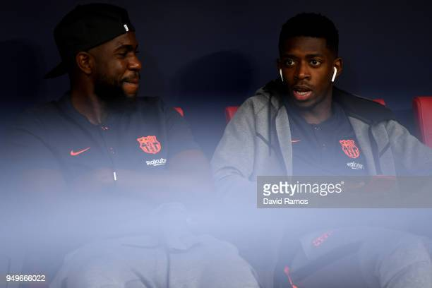 Barcelona pair Samuel Umtiti and Ousmane Dembele chat in the dug out ahead of the Spanish Copa del Rey Final between Barcelona and Sevilla at Wanda...