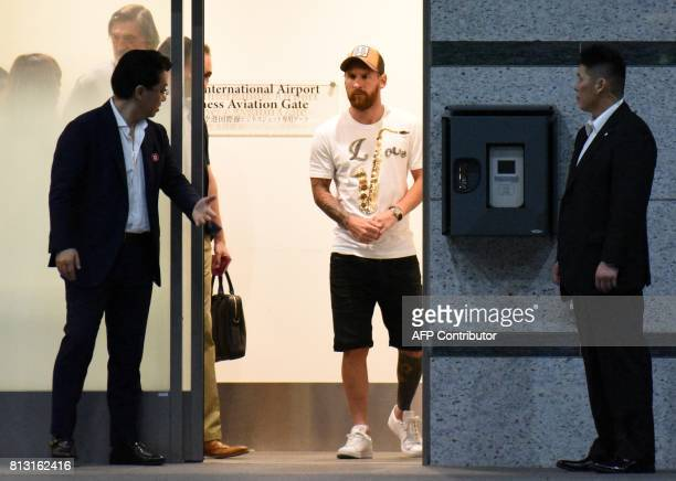 Barcelona player Lionel Messi arrives at Tokyo's Haneda Airport on July 12, 2017. Messi and his teammates are here to attend a press conference to...