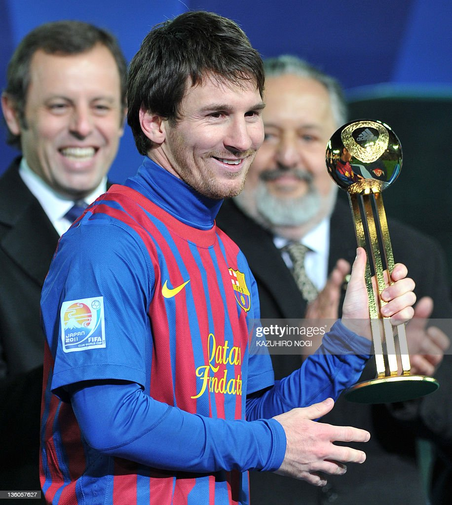 Barcelona Player Lionel Messi Holds The Adidas Gold Ball Trophy During Awarding Ceremony After