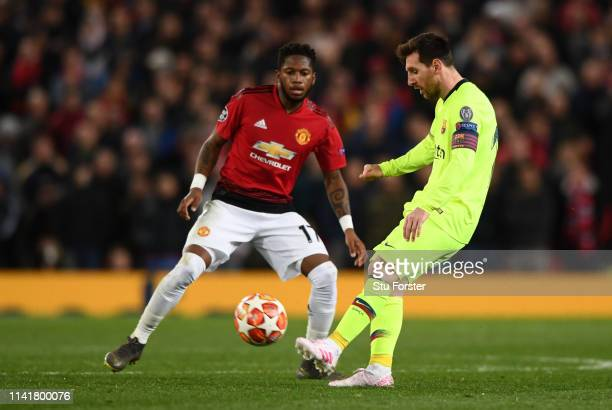 Barcelona player Lionel Messi in action as Fred looks on during the UEFA Champions League Quarter Final first leg match between Manchester United and...