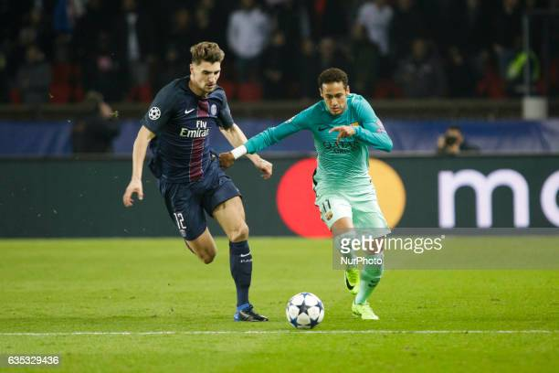 FC Barcelona player Neymar vies with PSG Thomas Meunier during the UEFA Champions League round of 16 first leg football match between Paris...