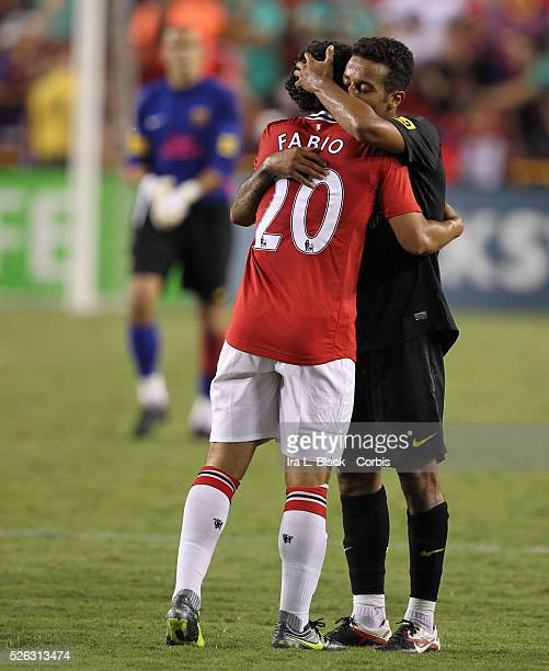 Barcelona player Thiago Alcantara hugs Manchester United player Fabio after the World Football Challenge Friendly match between FC Barcelona and...
