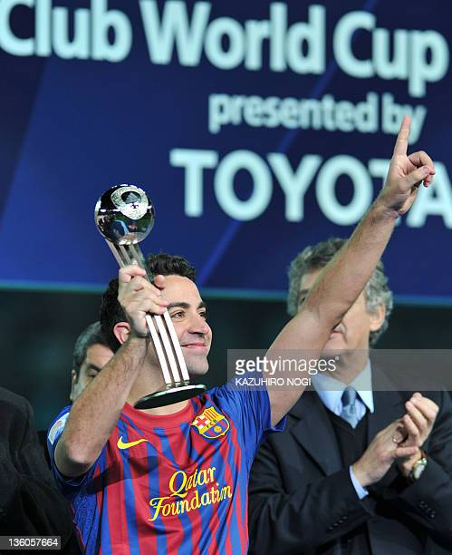 Barcelona player Xavi holds the Adidas Silver Ball Award during the awarding ceremony after the final football match against Santos at the Club World...