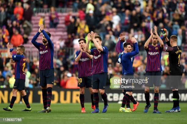 Barcelona players acknowledge the fans following the La Liga match between FC Barcelona and RCD Espanyol at Camp Nou on March 30 2019 in Barcelona...