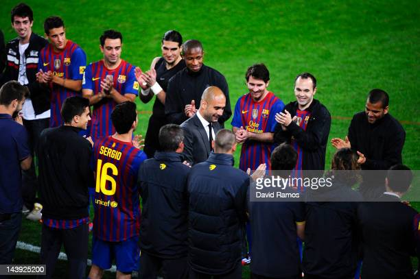 Barcelona players acknowledge their head coach Josep Guardiola at the end of the La Liga match between FC Barcelona and RCD Espanyol at Camp Nou on...