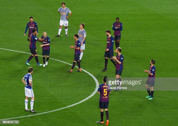 Barcelona players acknowledge their team mate Andres Iniesta as he leaves the pitch during the La Liga match between Barcelona and Real Sociedad at...