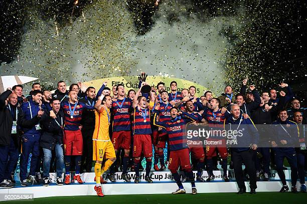 Barcelona players and coaching staff celebrate as captain Andres Iniesta of Barcelona lifts the trophy, following their 3-0 victory during the FIFA...