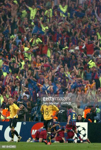 Barcelona players and fans celebrate Juliano Belletti's goal as Arsenal's Ashley Cole and Fredrik Ljungberg walk away dejected