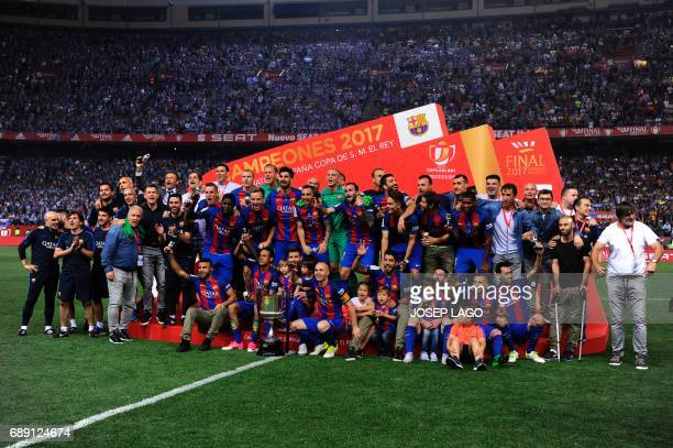 Barcelona players and staff pose with the trophy at the end of the Spanish Copa del Rey final football match FC Barcelona vs Deportivo Alaves at the...