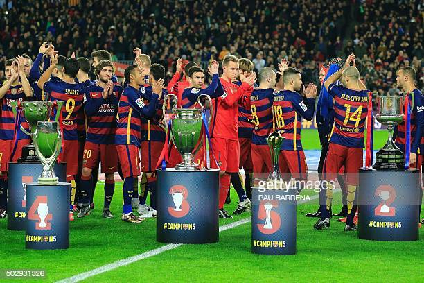 FC Barcelona players applaud after posing with their five trophies Spanish Liga UEFA Super Cup UEFA Champions League FIFA Club World Cup and Spanish...