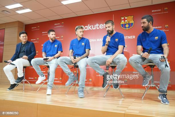 FC Barcelona players Arda Turan Gerard Pique Neymar and Lionel Messi attend a press conference with Rakuten Inc CEO Hiroshi Mikitani at the ecommerce...