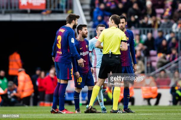 FC Barcelona players arguing with the referee during the La Liga match between FC Barcelona v Celta de Vigo at Camp Nou Stadium on December 2 2017 in...