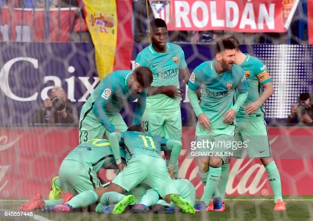 Barcelona players celebrate a goal during the Spanish league football match Club Atletico de Madrid vs FC Barcelona at the Vicente Calderon stadium...