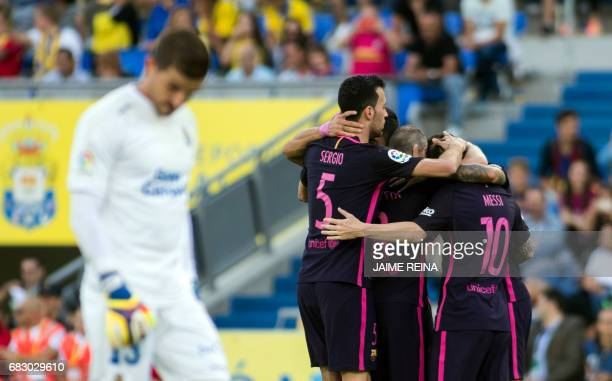 Barcelona players celebrate a goal during the Spanish league football match UD Las Palmas vs FC Barcelona at the Gran Canaria stadium in Las Palmas...