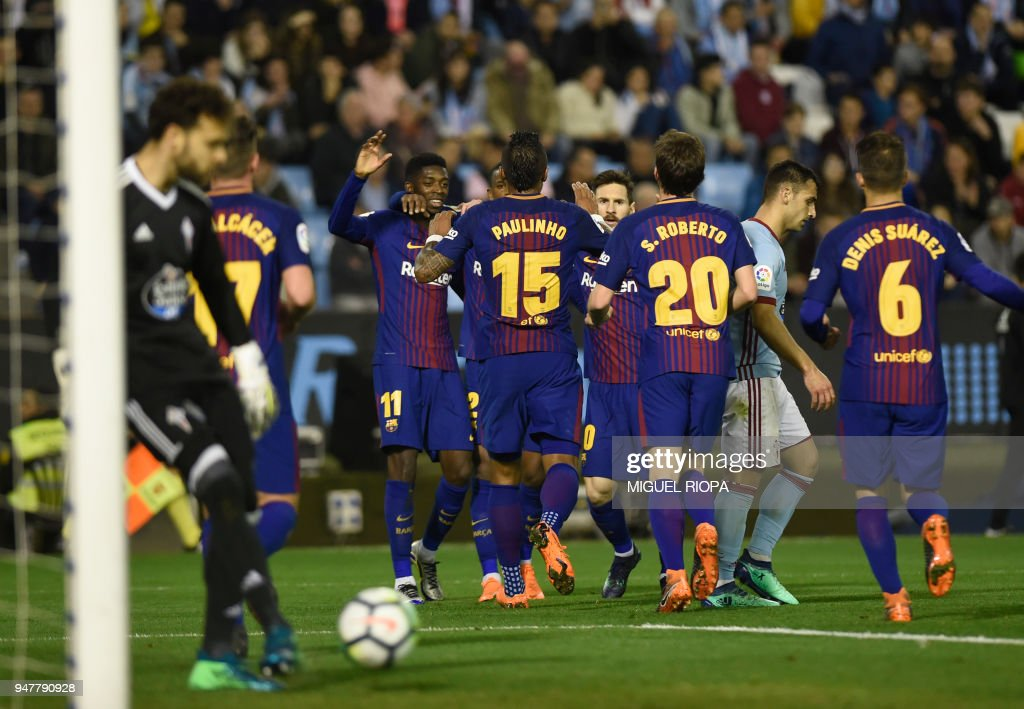 FC Barcelona players celebrate a goal scored by Spanish forward Paco Alcacer (2L) during the Spanish league football match between RC Celta de Vigo and FC Barcelona at the Balaidos stadium in Vigo on April 17, 2018. /