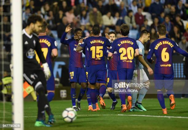 FC Barcelona players celebrate a goal scored by Spanish forward Paco Alcacer during the Spanish league football match between RC Celta de Vigo and FC...