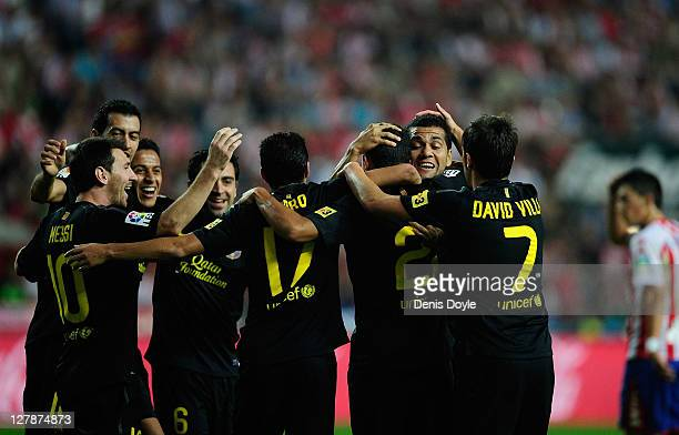 Barcelona players celebrate after Adriano scored Barcelona's opening goal during the La Liga match between Real Sporting de Gijon and FC Barcelona at...