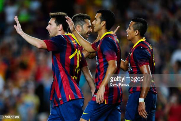 Barcelona players celebrate after Alexis Sanchez of FC Barcelona scored his team's third goal during a friendly match between FC Barcelona and Santos...