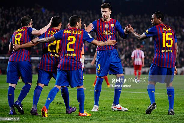 Barcelona players celebrate after Andres Iniesta scored the opening goal during the La Liga match between FC Barcelona and Sporting Gijon at Camp Nou...