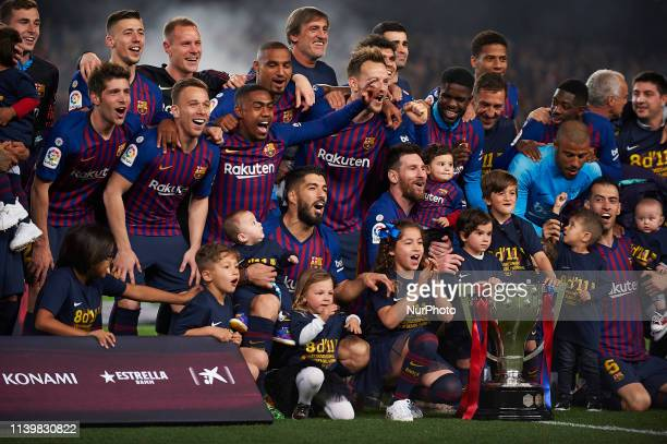 Barcelona players celebrate after Barcelona won their 26th league title at the end of the Spanish League football match between Barcelona and Levante...