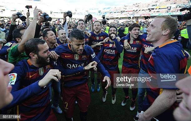 Barcelona players celebrate after beating Granada CF 03 to clinch the La Liga title during the La Liga match between Granada CF and FC Barcelona at...