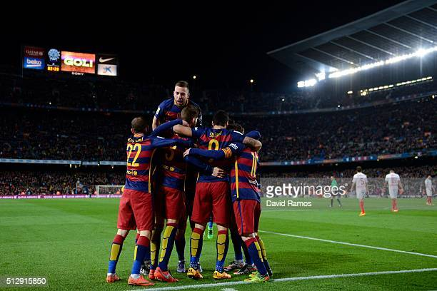 Barcelona players celebrate after Gerard Pique of FC Barcelona scored his team's second goal during the La Liga match between FC Barcelona and...
