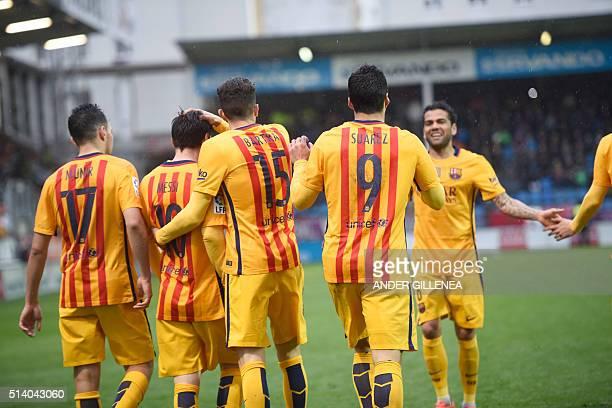 Barcelona players celebrate after scoring during the Spanish league football match SD Eibar vs FC Barcelona at the Ipurua stadium in Eibar on March 6...