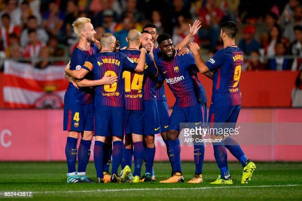 Barcelona players celebrate after scoring during the Spanish league football match Girona FC vs FC Barcelona at the Montilivi stadium in Girona on...