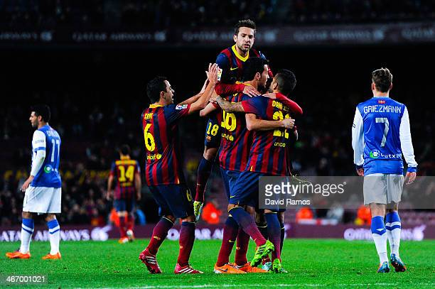 Barcelona players celebrate after Sergio Busquets of FC Barcelona scores the opening goal during the Copa del Rey SemiFinal first leg match between...