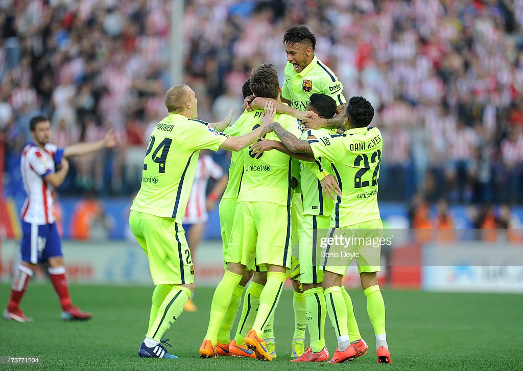 FC Barcelona players celebrate after winning the La Liga at the end of the La Liga match between Club Atletico de Madrid and FC Barcelona at Vicente Calderon Stadium on May 17, 2015 in Madrid, Spain.