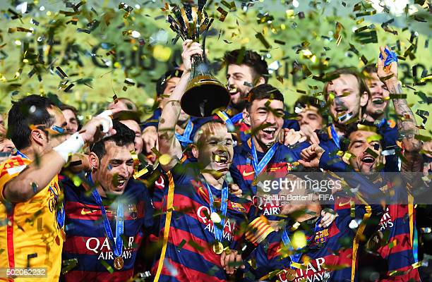 Barcelona players celebrate as captain Andres Iniesta of Barcelona lifts the trophy following their 30 victory during the FIFA Club World Cup Final...