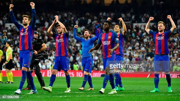 Barcelona players celebrate at the end of the Spanish league football match Real Madrid CF vs FC Barcelona at the Santiago Bernabeu stadium in Madrid...