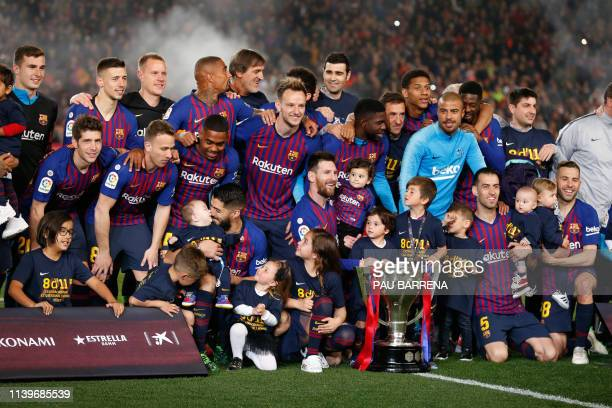 Barcelona players celebrate becoming La Liga champions after winning the Spanish League football match between FC Barcelona and Levante UD at the...