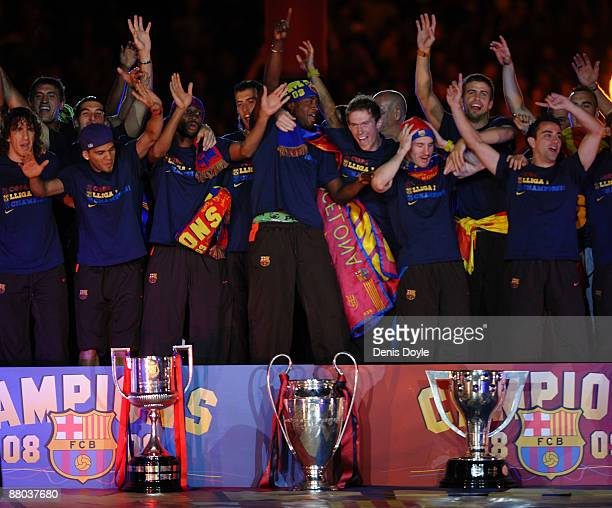 Barcelona players celebrate beside their three thophys Copa del Rey UEFA Champions League and La Liga at the Nou Camp Stadium the day after Barcelona...