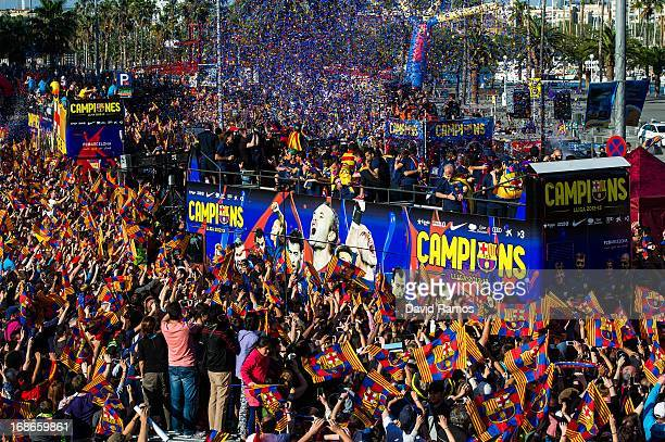 Barcelona players celebrate on an open top bus during their victory parade after winning the Spanish Liga title on May 13 2013 in Barcelona Spain