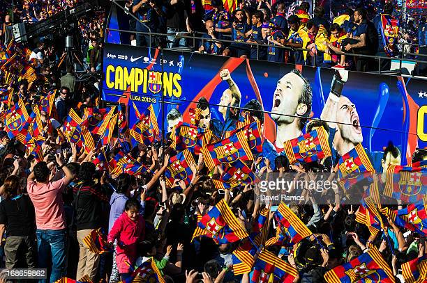 Barcelona players celebrate on the open top bus during the celebrations for winning the Spanish Liga on May 13 2013 in Barcelona Spain