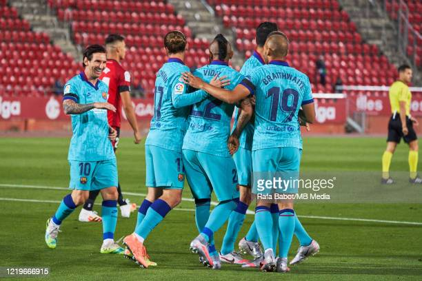 Barcelona players celebrate the 01 during the Liga match between RCD Mallorca and FC Barcelona at Iberostar Estadi on June 13 2020 in Mallorca Spain