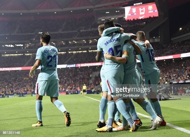 Barcelona players celebrate their goal during the Spanish league football match Club Atletico de Madrid vs FC Barcelona at the Wanda Metropolitano...