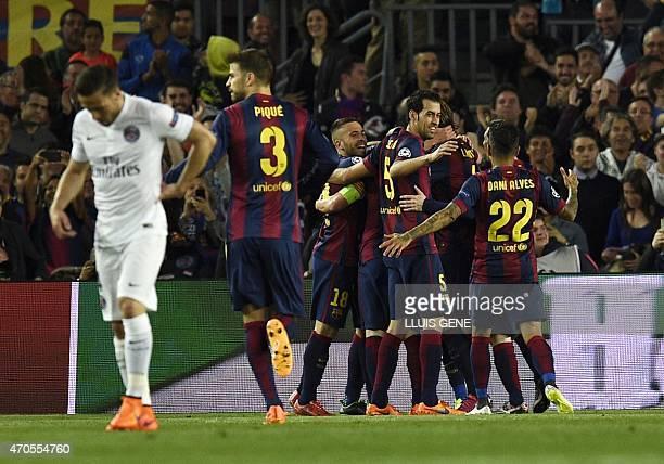 Barcelona players celebrate their opener during the UEFA Champions League quarter-finals second leg football match FC Barcelona vs Paris...
