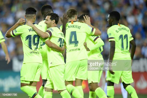 Barcelona players celebrate their opening goal during the Spanish league football match Club Deportivo Leganes SAD against FC Barcelona at the...